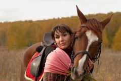 Best friends. Young girl hugging her horse Royalty Free Stock Images
