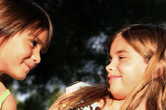 Best Friends. Soft Focus portrait of two young girls smiling at each other ~ Best Friends Royalty Free Stock Photo