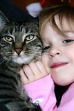Best Friends. Adorable little girl hugging her pet cat royalty free stock images
