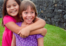 Best Friends. A couple of young girls from different backgrounds are best friends in Hawaii Royalty Free Stock Images