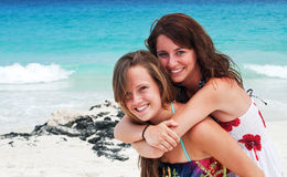 Best friends. Two young women enjoy a day at the beach Stock Images