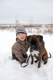 Best friends. Boy with dog in snow Royalty Free Stock Photo