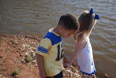 Best Friends. A pair of young kids down by the water holding hands on a late summer afternoon Stock Images