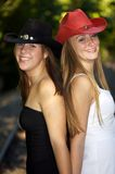 Best of Friends. Two beautiful cowgirls in the great outdoors stock images