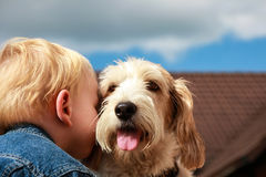 Best friends. A child boy gives his best friend dog a hug Royalty Free Stock Image