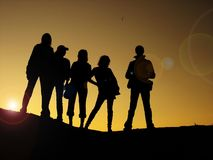 Best friends. Silhouettes posing for a picture stock image