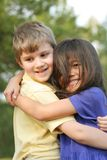 Best of friends. Best friends, boy and girl,hugging and smiling. Diversity, multicultural image Royalty Free Stock Image