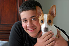 Best Friends. A teenage boy and his dog stock photography