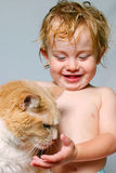 Best friends. A young smiling boy with a cat Royalty Free Stock Photography