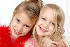 Best Friends. Two young girls who look like sisters smile for the camera and do it with a hug. We could be sisters, but we are not. two of a kind Royalty Free Stock Images