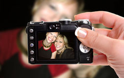 Best friends. Woman takes snapshop of best friends smiling Stock Images