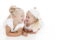 Best friends. Two cute little girls dressed in white being best friends Royalty Free Stock Images