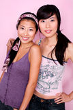 Best Friends. Portrait of Two Asian Best Friends against Pink Background Royalty Free Stock Images