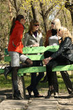Best friends. Women friends talking about fashion in a city park Stock Photos