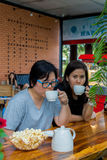 Best friends asian women drinking in coffee shop Royalty Free Stock Photos