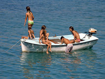 Best friends in boat at sea. Young Boy and girls (best friends) enjoy on boat in Adriatic sea -spending summer holidays (Croatia-Dalmatia Royalty Free Stock Images