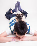 Best Friends A boy with a puppy on his back Royalty Free Stock Photo
