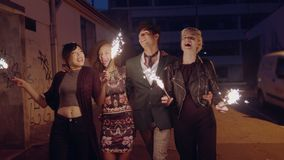 Best friends celebrating new years eve with sparklers stock video