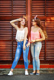 Best friends are dressed in the style of pin-up. Girls laugh. Stock Photo