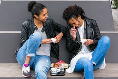 Best friends drinking coffee in city Stock Images