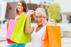 Best Friends Enjoying The Deserved Shopping Day Royalty Free Stock Image