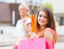 Best Friends Enjoying The Deserved Shopping Day. Beautiful girlfriends out in town for a shopping Royalty Free Stock Images