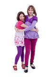 Best friends forever. Young girls hugging, isolated Stock Photography