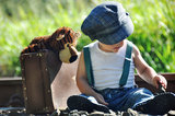 Best friends forever-baby boy & teddy bear toy. A portrait of a very cute toddler aged boy dressed in vintage old fashioned style clothing including a Royalty Free Stock Photos