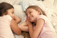 Best friends forever. Girls relaxing on bed. Slumber party concept. Girls just want to have fun. Invite friend for royalty free stock images
