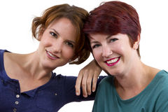 Best Friends Forever. Two women posing on white background as Best Friends Forever Stock Photography