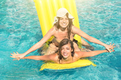 Best friends girlfriends in bikini - Fun together Royalty Free Stock Photography
