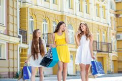 Best friends. Girls holding shopping bags and walk to the shops. Stock Photography