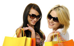 Best friends go shopping. Beautiful blonde and brunette carry their shopping bags together Stock Photo