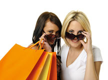 Best friends go shopping. Beautiful blonde and brunette carry their shopping bags together Royalty Free Stock Photos