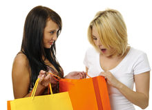 Best friends go shopping. Beautiful blonde and brunette carry their shopping bags together Stock Photography