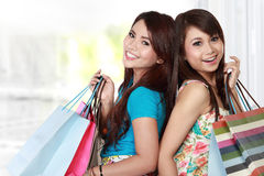 Best friends go shopping. Happy shopping two girl holding many bag in hand. isolated white background Stock Photo