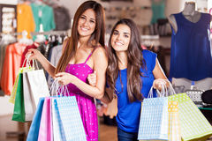 Best friends going shopping. Happy women carrying shopping bags and doing some shopping together Stock Photo
