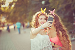 Best friends. Group selfies. Toning. Best girlfriends do photos. Group selfies. Girls dressed in the style of Pin-up girl. Hipster. Warm toning. The concept of Royalty Free Stock Photography