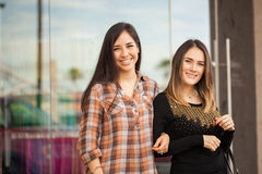 Best friends hanging out at a shopping mall. Portrait of a couple of girlfriends visiting a shopping mall together Royalty Free Stock Image