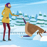 Best friends having fun at the ice rink. She dropped her head into the snow, and he laughs - practical joke concept Stock Image