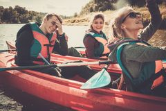 Best friends having fun on a kayaks stock images