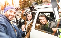 Best friends having fun taking selfie at car with ski and snowboard. Best friends having fun taking selfie at car for ski and snowboard on mountain trip royalty free stock photos