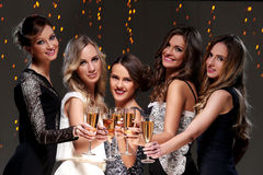 Best friends having a new year party. Girls with a glass of champagne have new year party Stock Images