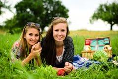 Best friends having a picnic Stock Images
