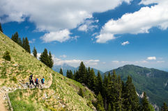 Best friends hiking on a gorgeous Alpine slope on a sunny summer day. Best friends hiking on a gorgeous Alpine valley on a sunny summer day with dramatic sky royalty free stock image