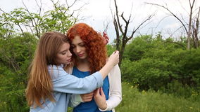 Best friends hug gently. stock footage