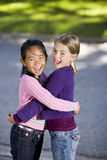 Best friends hugging and laughing Stock Photography