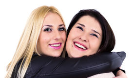 Best friends hugging and smiling. Isolated on white Royalty Free Stock Photography