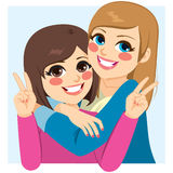 Best Friends Hugging. Two lovely happy best friends girls hugging Royalty Free Stock Photography