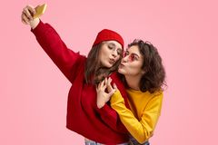 Best friends kissing and taking selfie royalty free stock photos